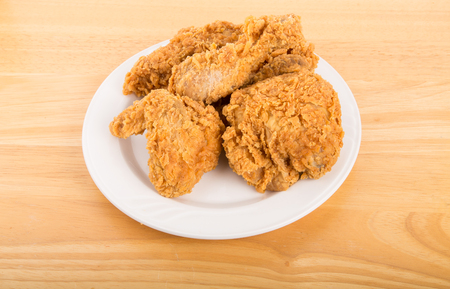 A white plate with fresh, crispy fried chicken Stok Fotoğraf