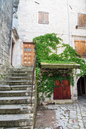 Steps in an old building in Kotor, Montenegro photo