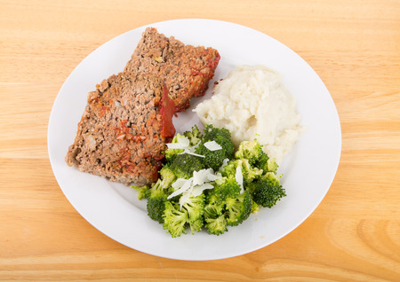 meatloaf: Slices of home made meatloaf with mashed potatoes and broccoli