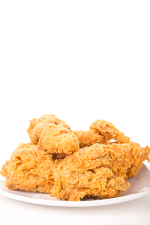 A white plate with fresh, crispy fried chicken photo