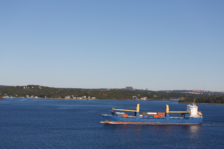 Freighter sailing through calm blue waters off the coast of Halifax