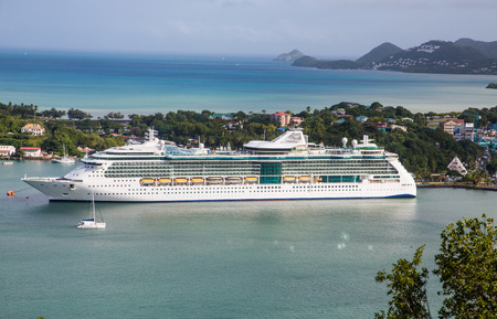 st lucia: Luxury cruise ship docked in harbor of St Lucia in the Caribbean Stock Photo