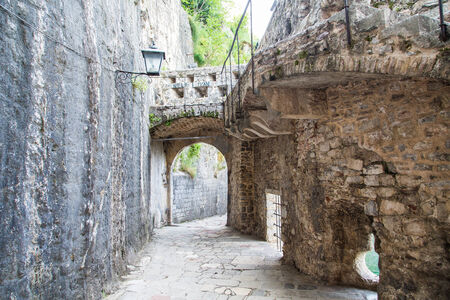 Ancient stone walls and walkway in the walled city of Kotor photo