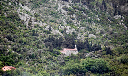 An old stone church clinging to a mountainside near Kotor in Montenegro