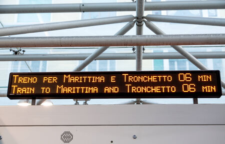 arrivals: Sign in Italian train station showing arrivals Stock Photo