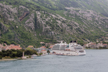 White Luxury Cruise ship at port in Kotor, Montenegro photo