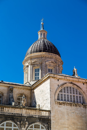 Old domed church in the walled city of Dubrovnik under clear blue skies Stock Photo