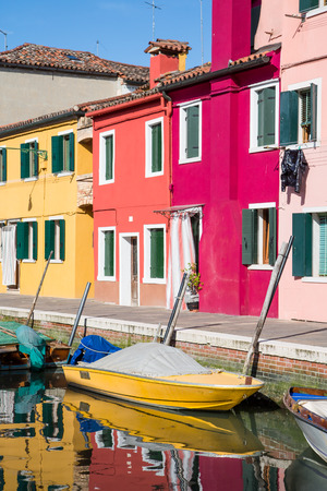 Boats in Canal by Colorful Burano Homes