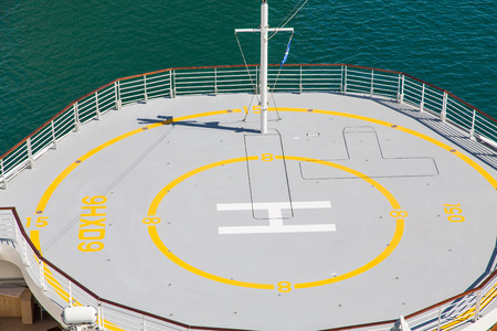 helicopter pad: Helicopter pad on the bow of a luxury cruise ship