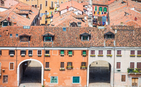 large doors: Driveway doors in large Venice buildings under tile roofs Stock Photo