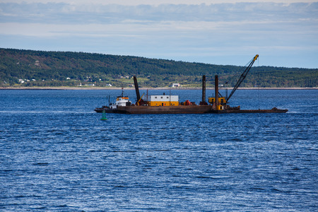A working barge off the coast of Nova Scotia Canada photo