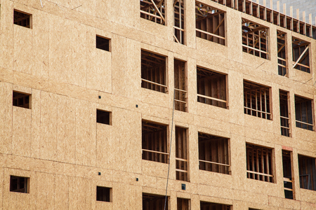 sheathing: Wood sheathing panels on new apartment or condominium constuction