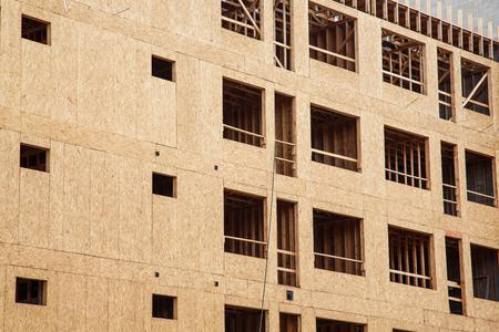 sheathing: Wood sheathing panels on new apartment or condominium constuction