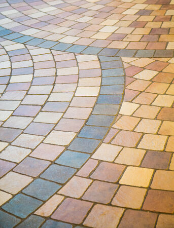 tile flooring: Colorful patterns on a tile fllor for background and texture