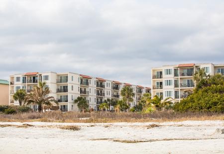 A nice three-story beach condominium complex photo