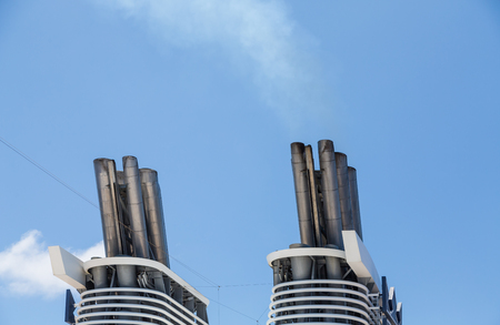 pile engine: Smokestacks on a luxury cruise ship under a clear blue sky Stock Photo