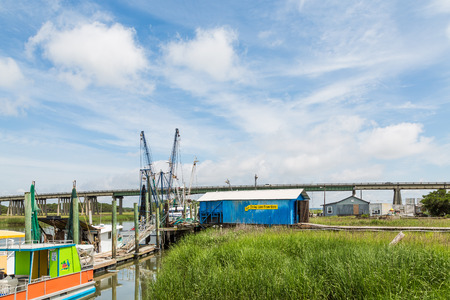 salt marsh: Shrimp boats docked by a salt water marsh