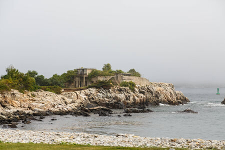 rocky point: An old, storm beaten house on a rocky point of land in Maine