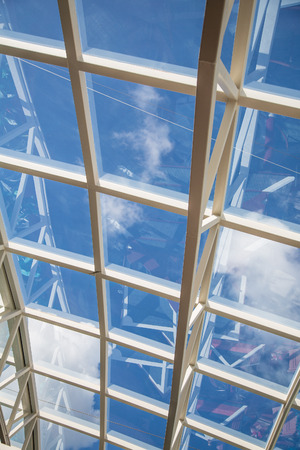 White steel and glass atrium ceilings under blue skies Stock Photo