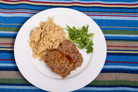 Meatloaf with brown rice and arugula