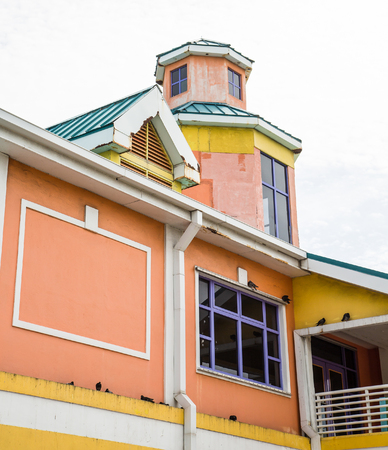 orange nassau: An old colorful building in Nassau Bahamas