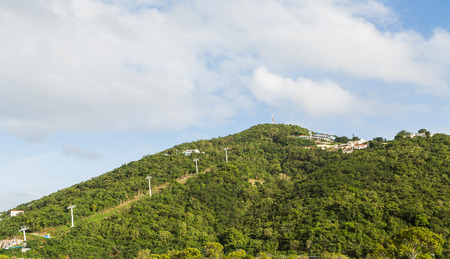 Skylift up green hills over St Thomas