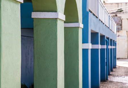 white trim: Blue and Green Plaster columns with white trim into distance