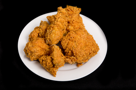 Fresh, crispy, fried chicken on a white plate Stok Fotoğraf