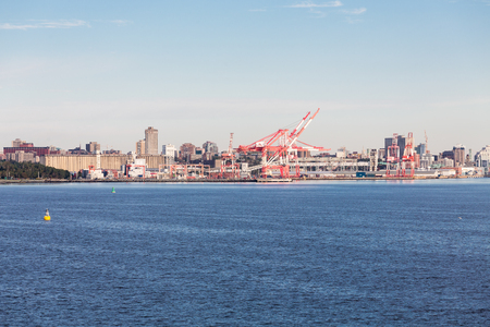 Red and white shipping cranes on the industrial coast of Halifax, Nova Scotia