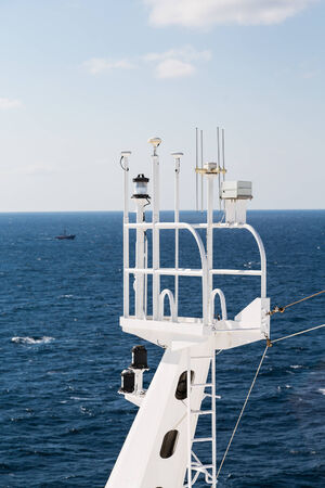 Modern communication equipment on tower of cruise ship Imagens