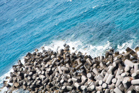seawall: Man made cement stones used as a seawall at a harbor