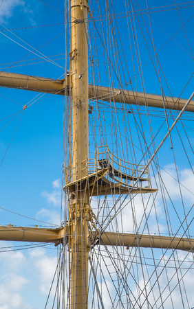 masts: Wood masts of an old clipper ship against a nice sky