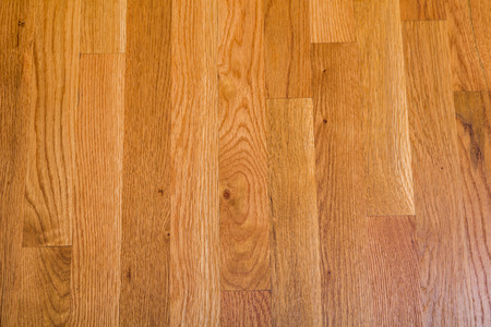 polished floor: A shiny, polished hardwood floor for background or texture