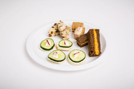pimento: A selection of tea sandwiches with sliced cucumber and pimento cheese Stock Photo