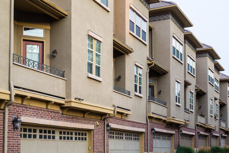 Modern condominiums with closed drive under garages 版權商用圖片 - 34671308