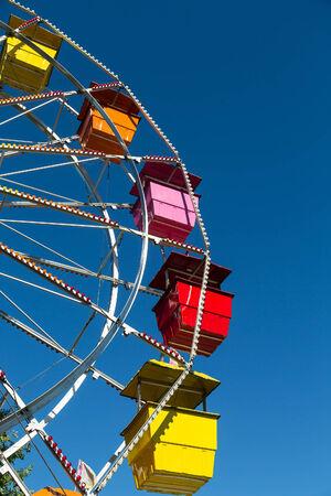 ferriswheel: Colorful ferris wheel on a deep blue sky