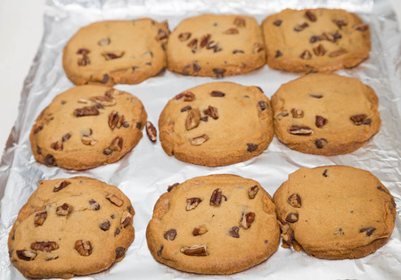 cookie sheet: Fresh Chocolate chip and caramel cookies on a cookie sheet lined with foil Stock Photo