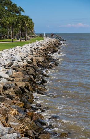 seawall: Rock seawall on the coast of Georgia Stock Photo