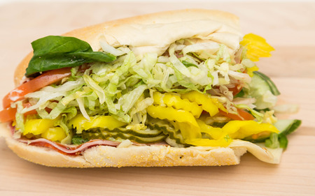 hoagie: A loaded italian sub sandwich with spinach, lettuce and peppers