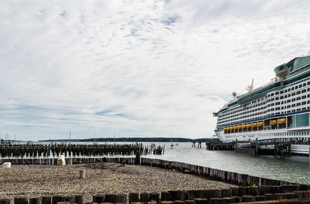 pilings: Huge Luxury cruise ship in Portland, Maine by old wood pilings