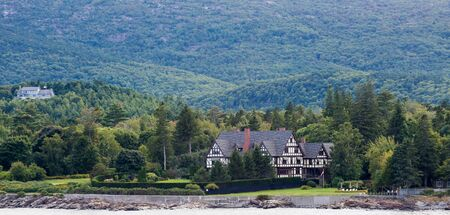 tudor: Large tudor mansion among evergreens on the coast of Maine near Bar Harbor