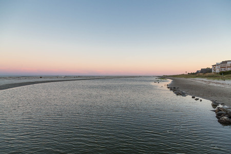 A shallow tidal pool at sunset or sunrise