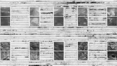 many windows: Many windows in an old weathered wood wall