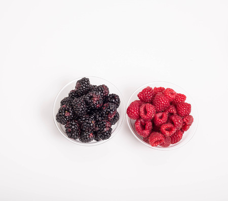 Fresh, ripe, juicy berries in clear cup on a white counter Reklamní fotografie