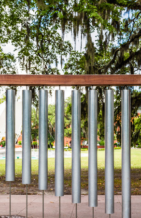 wind chimes: Large wind chimes of tubular bells in a public park