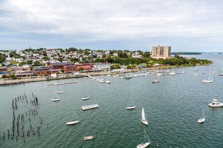 White Sailboats in Calm Blue Bay Stok Fotoğraf