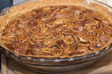 whole pecans: A whole freshly home made pecan pie ready to eat