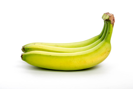 Bunch of green and yellow bananas on a white background Stock Photo