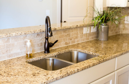 kitchen countertops: Modern empty kitchen with granite countertops Stock Photo