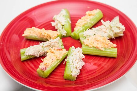 pimento: A healthy snack of celery sticks stuffed with pimento cheese and chicken salad Stock Photo